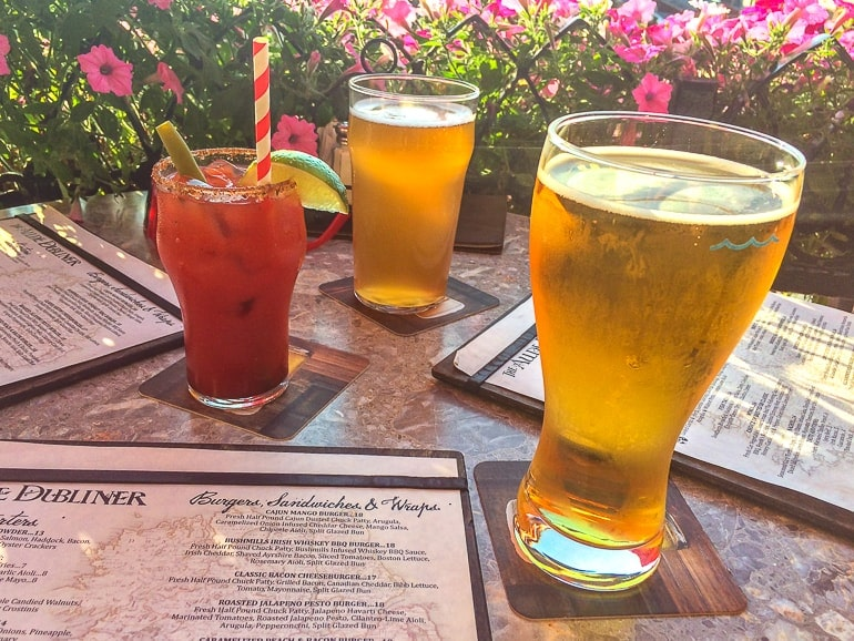 two pint glasses and caesar drink on table with menus at ottawa pub