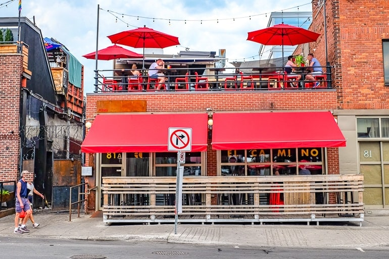 bar with red awning and upper patio with umbrealls ottawa pubs