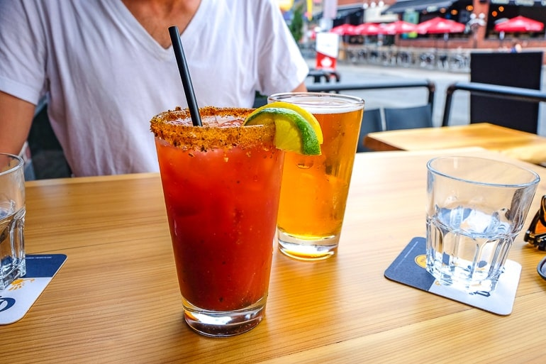 red Caesar drink with beer on wooden table furniture warehouse ottawa pubs