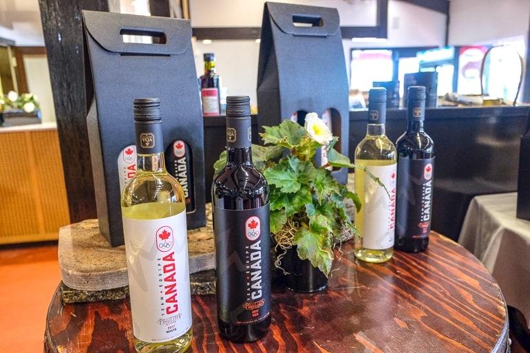 wine bottles on display on wooden table at pillitteri