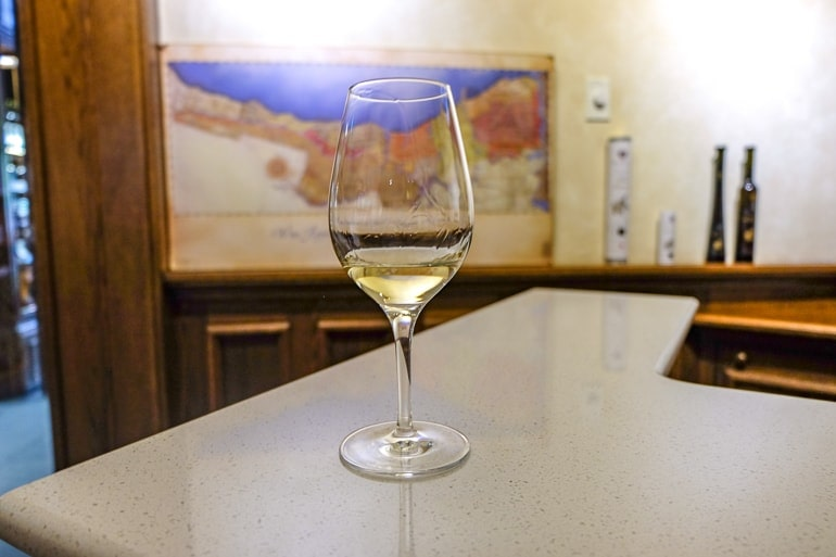 wine glass with ice wine on counter inside a winery