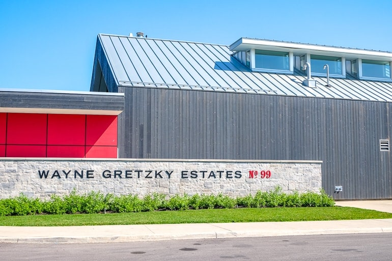 outside of winery with steel and stone wall niagara on the lake wineries gretzky