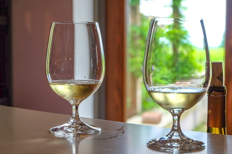 two wine glasses on counter with white wine at niagara on the lake
