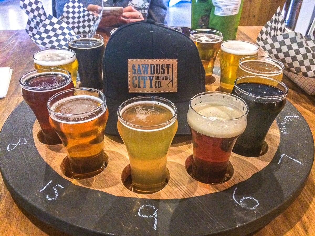 wooden wheel of beer sampling glasses with hat sawdust city brewery ontario away