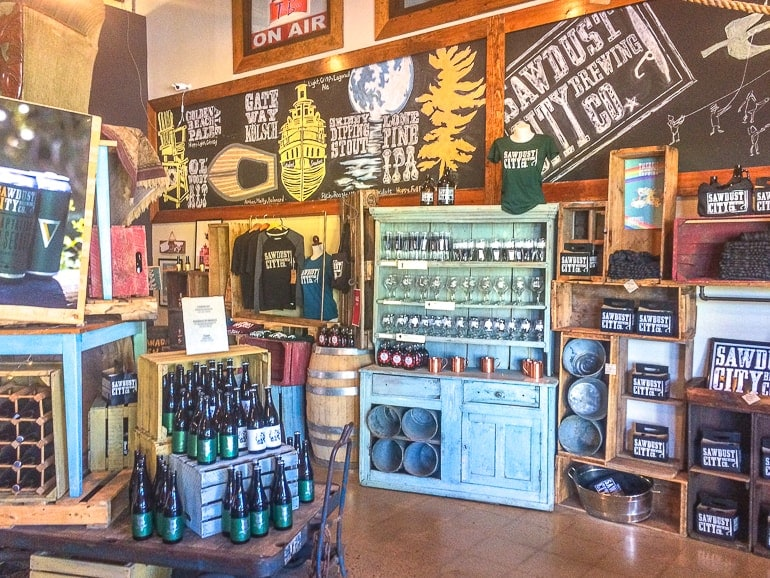 inside of store with clothes and products on shelves sawdust city brewery ontario away