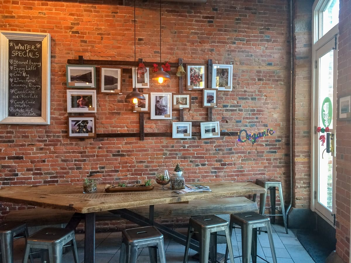 red brick interior and wooden table coffee shops kingston ontario