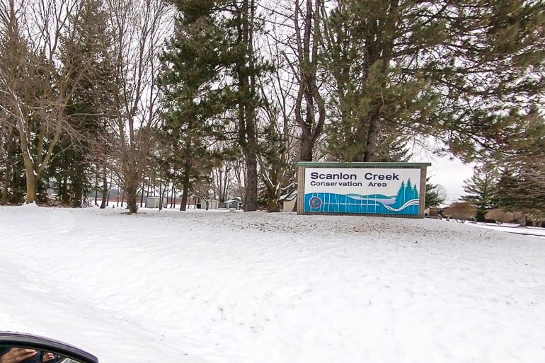 entrance sign with trees and snow in front scanlon creek conservation area
