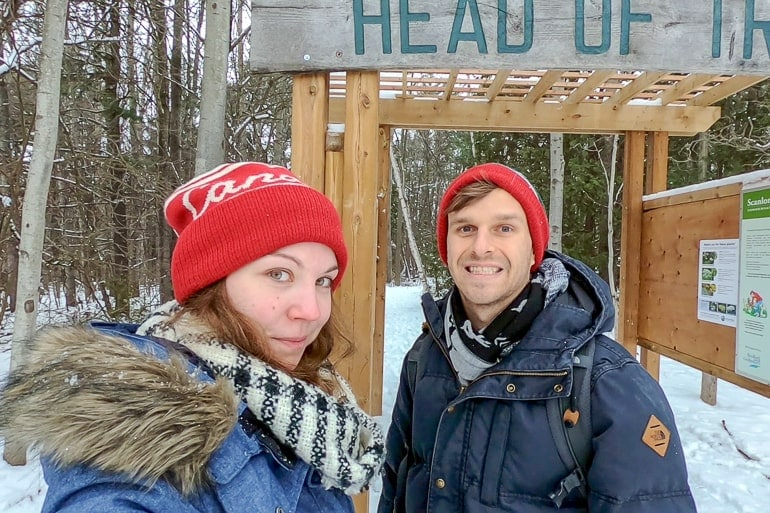 man and women in winter clothing standing outside scanlon creek conservation area