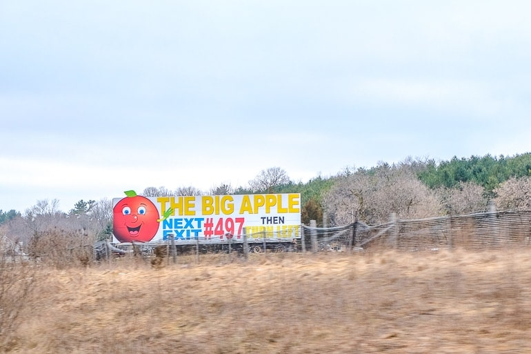 billboard on side of highway the big apple colborne ontario