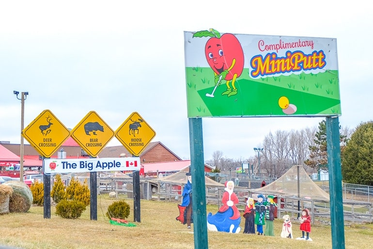 colourful road signs at the big apple colborne ontario