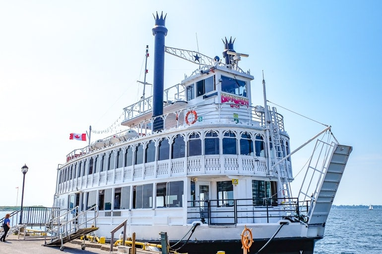 old white steam ship docked with water behind 1000 islands cruise kingston