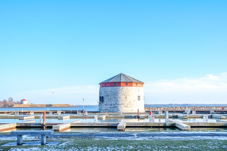 limestone tower with docks around and lake water things to do in kingston ontario shoal tower
