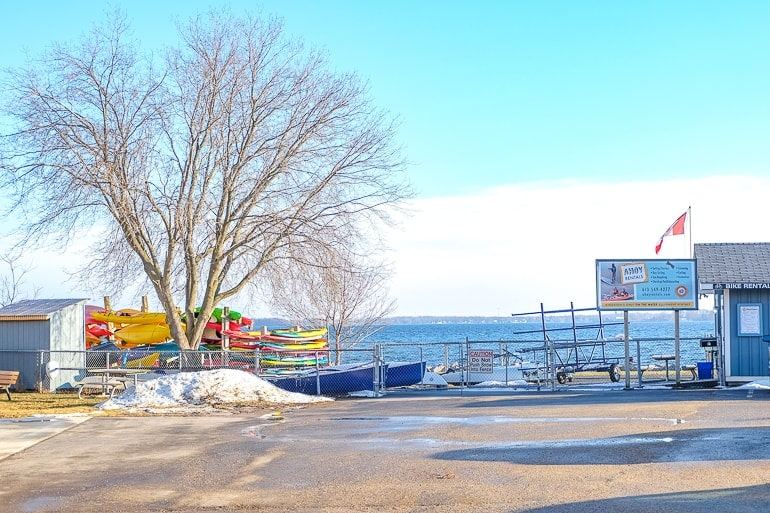 colourful kayaks and parking lot with lake behind things to do in kingston ontario