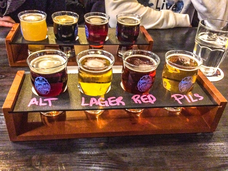flight of four beer on table things to do in kingston ontario santur brewery