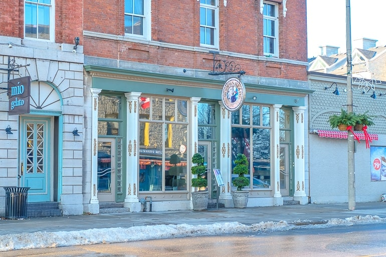 restaurant storefront with sign and sidewalk things to do in kingston ontario