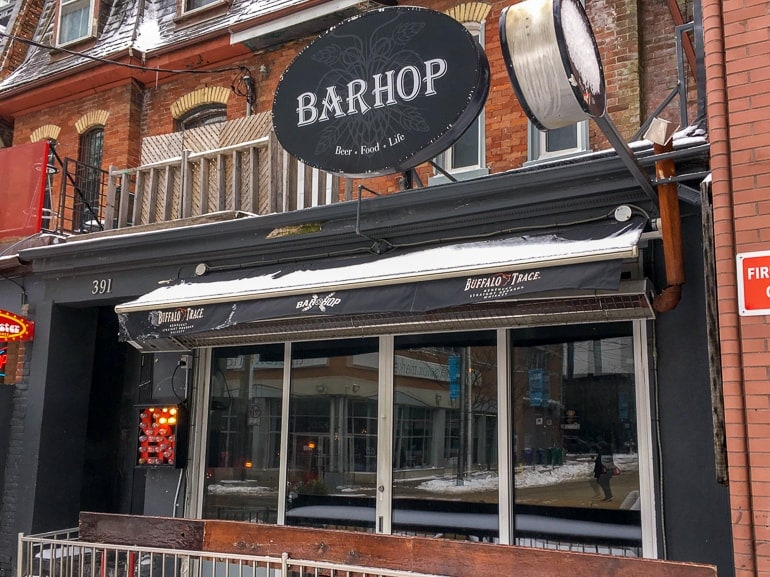 bar front with sign in red brick building bars in downtown toronto