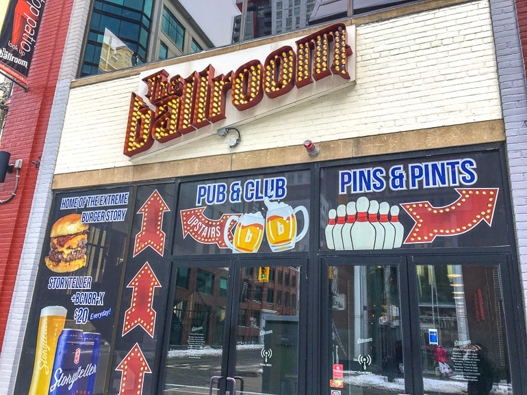 bar front entrance sign with lights bars in downtown toronto