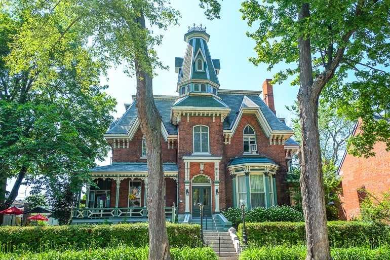colourful bed and breakfast house with tower and trees in front in kingston ontario