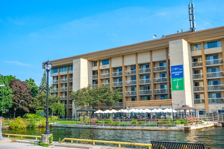 brown downtown hotel with balconies at water's edge holiday inn waterfront kingston