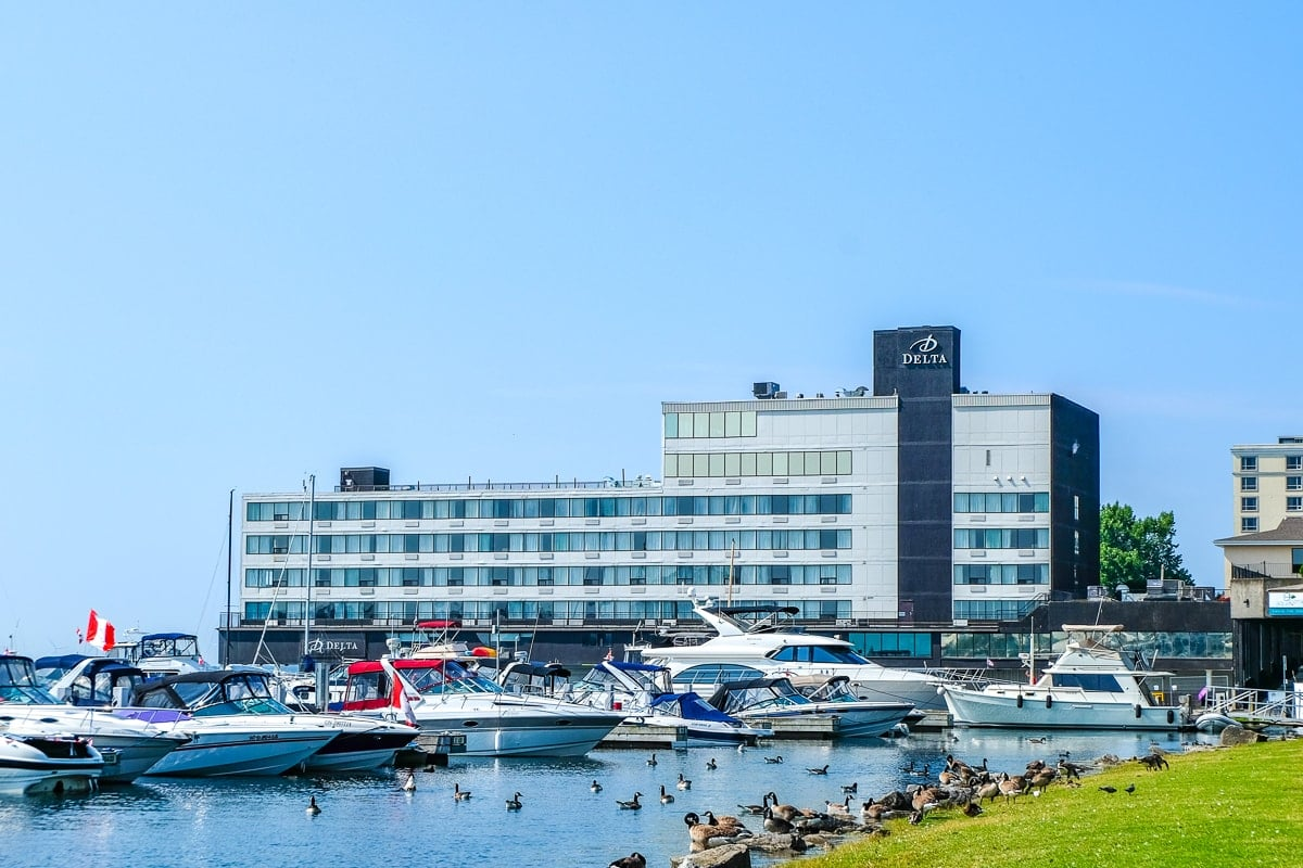 steel hotel on waterfront with boats in front places to stay in kingston ontario delta hotel by marriott