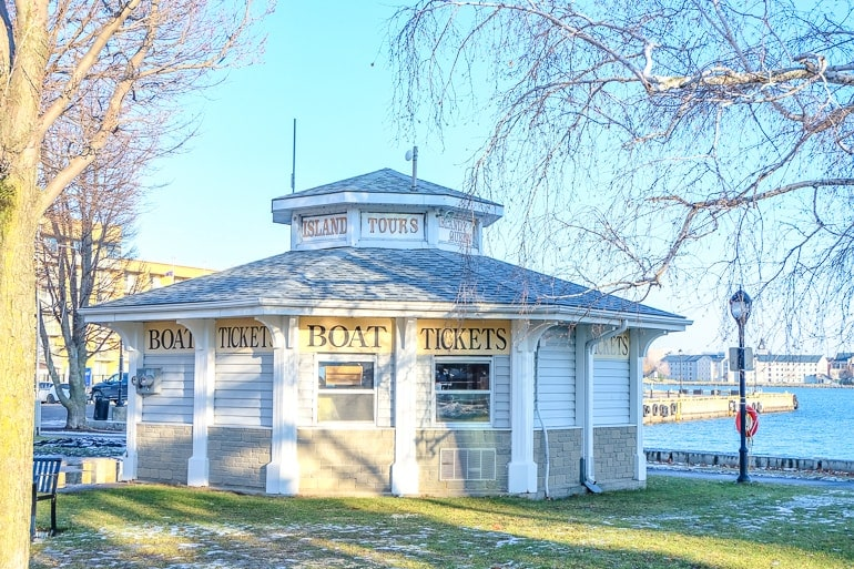 wooden ticket booth with water behind places to stay in kingston ontario