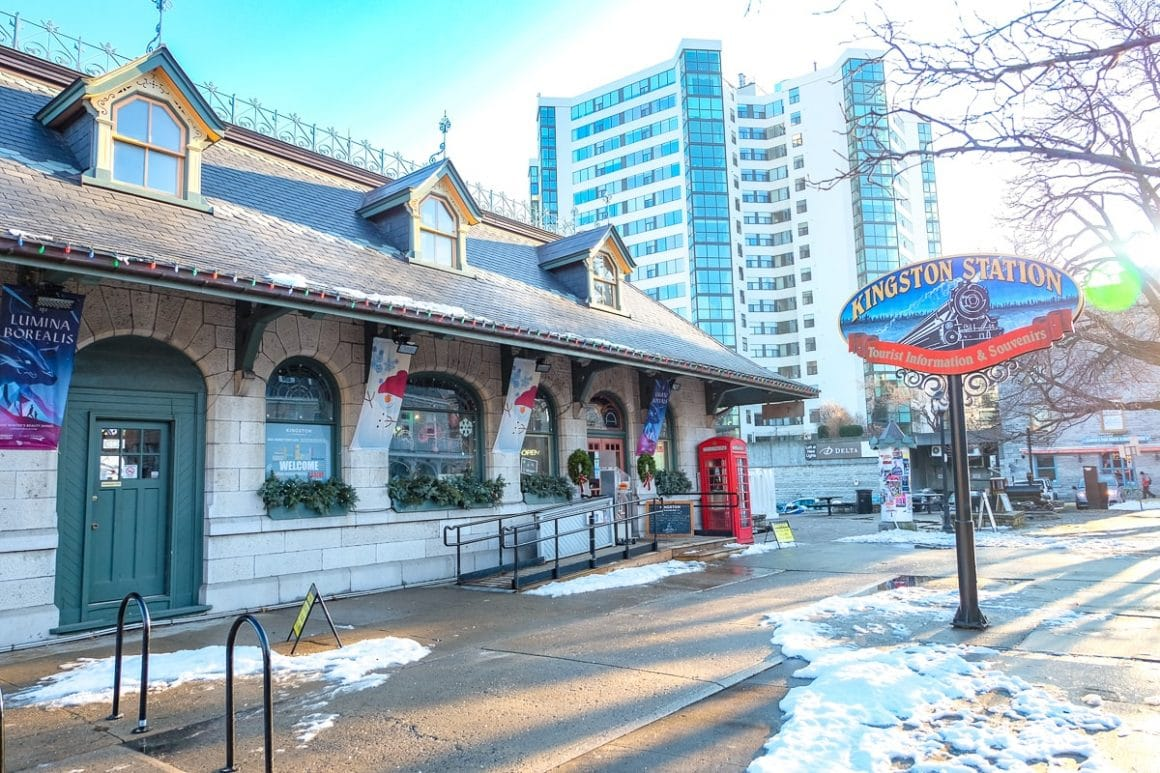 old train station with sign and hotel behind places to stay in kingston ontario