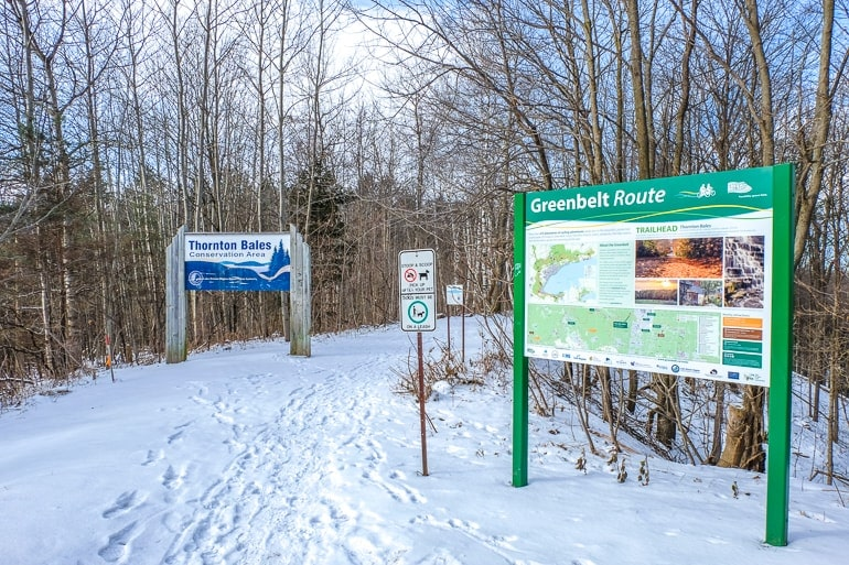 signs for hiking trail entrance in winter thornton bales conservation area