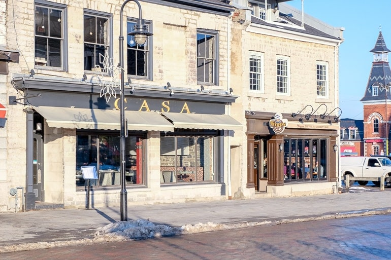 restaurant front in old stone building with street lamp in front casa kingston ontario