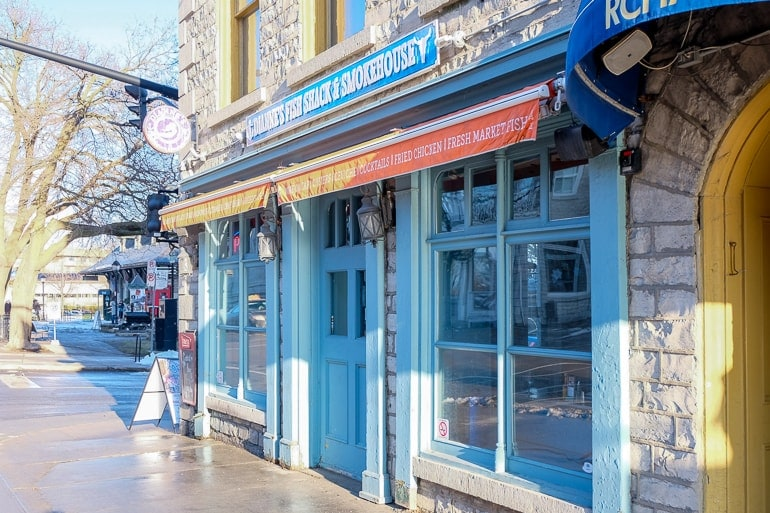 blue wooden and stone restaurant front with sidewalk diannes fish kingston ontario