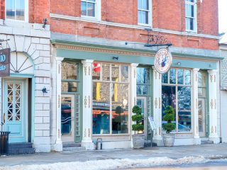 wooden restaurant front with brick and sidewalk in front restaurants kingston ontario