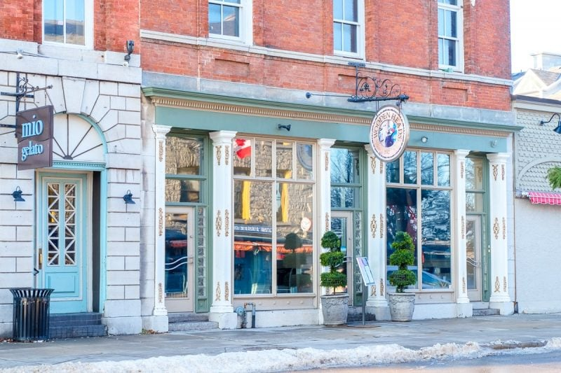 wooden restaurant front with brick and sidewalk in front restaurants kingston ontario