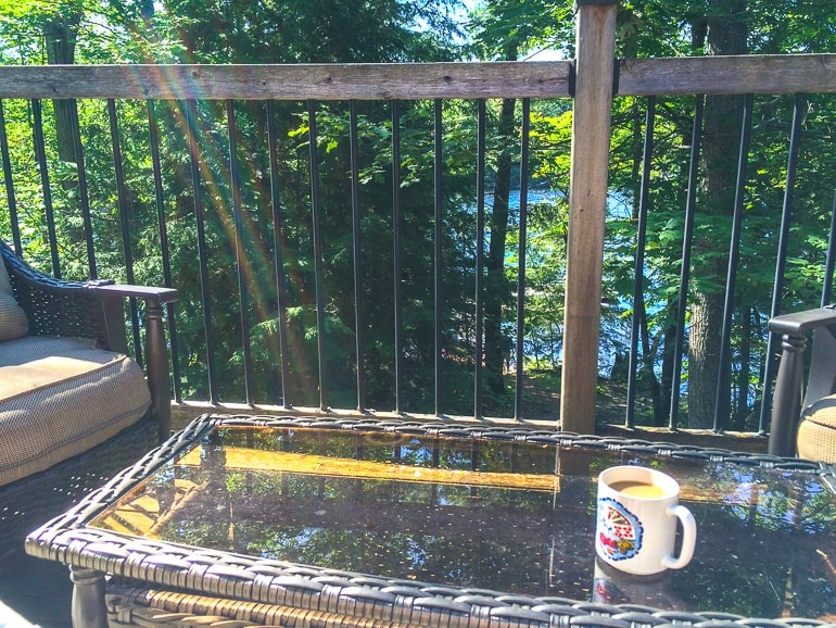 coffee mug in glass table on cottage deck in ontario
