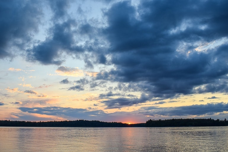 sunset over lake in ontario at cottage rental