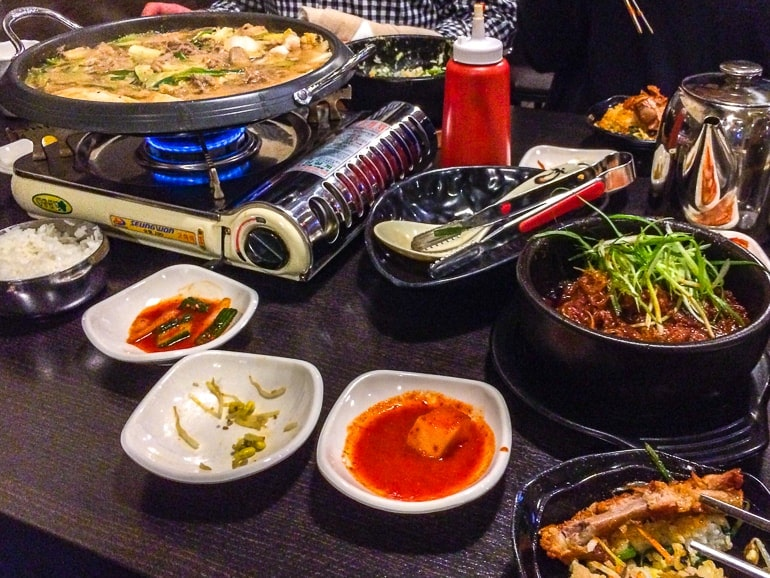 korean hot pot with bowls on table in restaurant visiting toronto