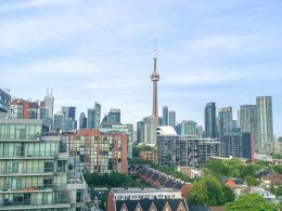 cn tower and apartments on city skyline visiting toronto