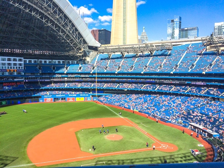 baseball field in stadium with blue seats visiting toronto rogers centre
