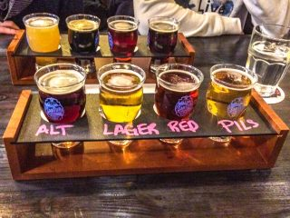 eight beer glasses on table with chalk names written bars pubs kingston ontario