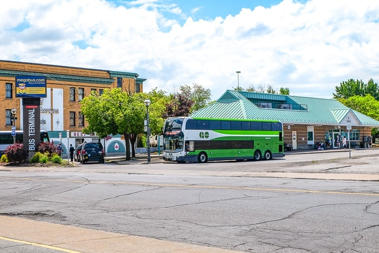 green bus at station in niagara falls from toronto