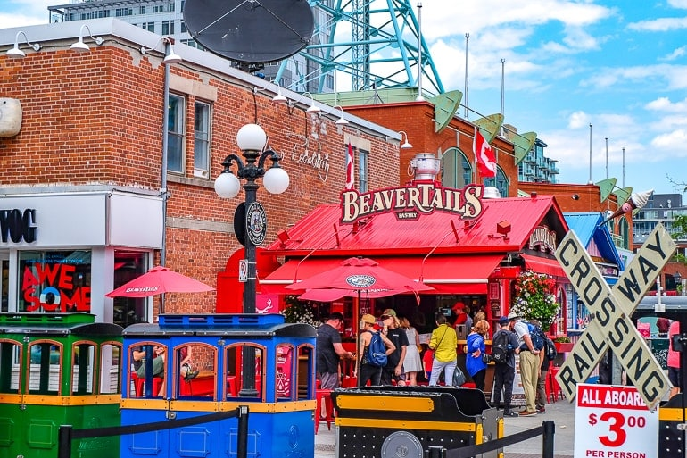 red shop in busy market selling pastries byward market beavertails ottawa