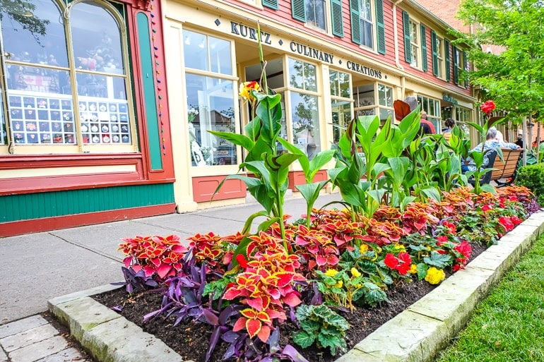 colourful gardens in front of shop front and sidewalk niagara on the lake