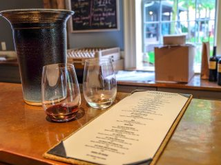 wine glasses on bar with menu niagara on the lake wine tours