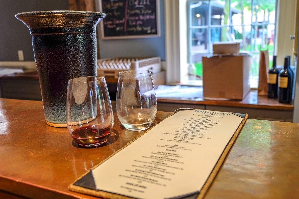 wine glasses on bar with menu niagara on the lake wine tours