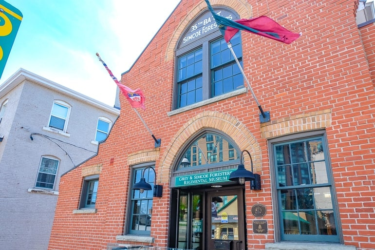 red brick museum with flag in front barrie ontario