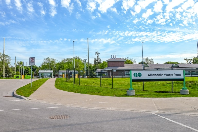train station with green grass and sign in front go station things to do in barrie