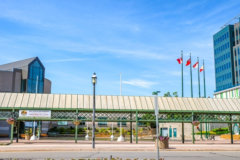 metal covered market area with fountain and flags barrie city hall