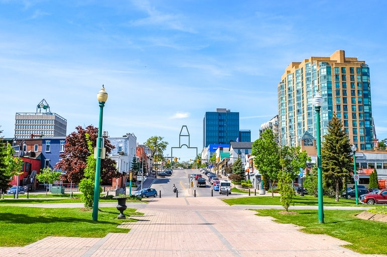large sidewalk with downtown city buildings around barrie ontario