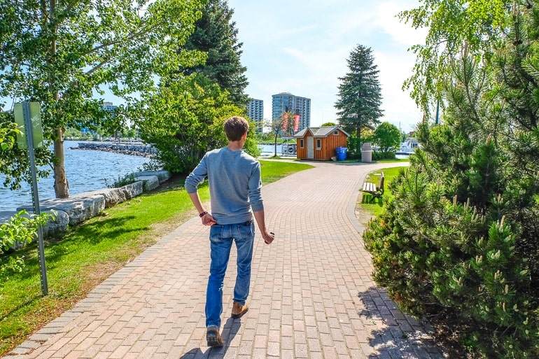 man walking down waterfront pathways things to do in barrie ontario