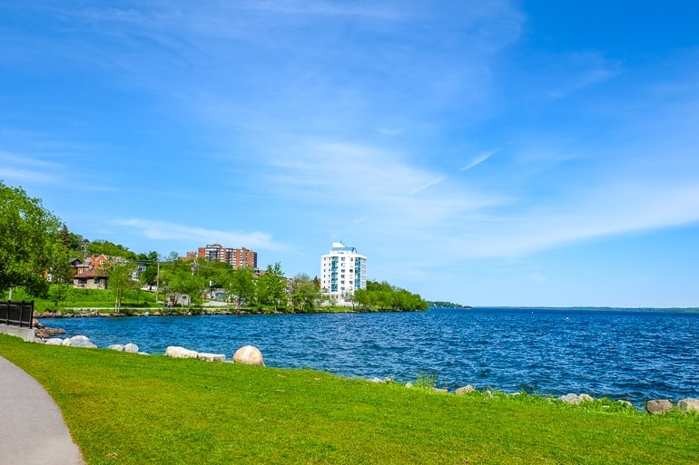 green grass looking out over blue water in barrie ontario