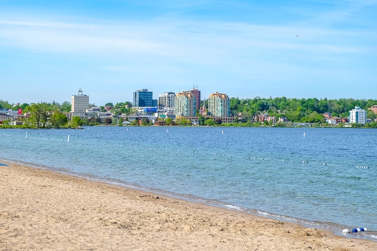 blue bay water with sandy beach in front barrie ontario