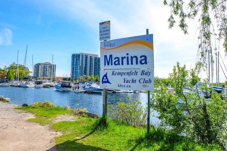 marina sign with boats in the water behind things to do in barrie